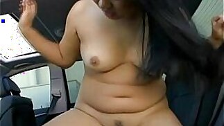 Busty Asian being naughty in the car